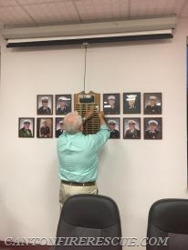Past Chief Dalton places Past Chief Crowe's name on the Past Chiefs Plaque.